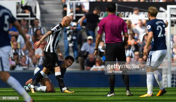 Dele Alli of Tottenham Hotspur reacts after an incident leading to a red card for Jonjo Shelvey of Newcastle United during the Premier League match...