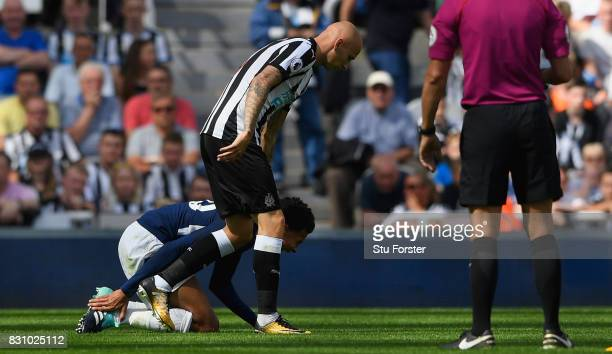 Dele Alli of Tottenham Hotspur reacts leading to a red card for Jonjo Shelvey of Newcastle United during the Premier League match between Newcastle...