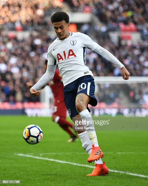 Dele Alli of Tottenham Hotspur runs with the ball during the Premier League match between Tottenham Hotspur and Liverpool at Wembley Stadium on...