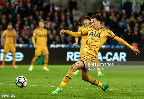 Dele Alli of Tottenham Hotspur scores his sides first goal during the Premier League match between Swansea City and Tottenham Hotspur at the Liberty...