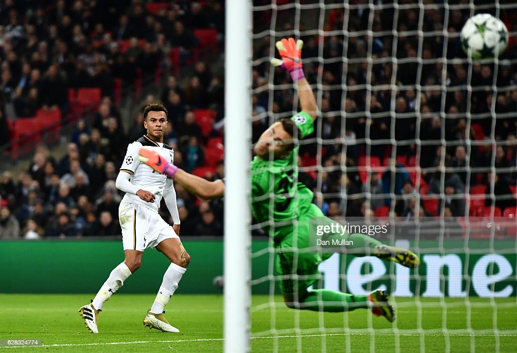 Dele Alli of Tottenham Hotspur (C) scores his sides first goal past Igor Akinfeev of CSKA Moscow (R) during the UEFA Champions League Group E match between Tottenham Hotspur FC and PFC CSKA Moskva at Wembley Stadium on December 7, 2016 in London, England.