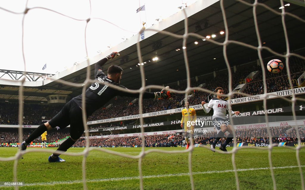 Dele Alli of Tottenham Hotspur (R) scores his sides fourth goal past Tom King of Millwall (L) during The Emirates FA Cup Quarter-Final match between Tottenham Hotspur and Millwall at White Hart Lane on March 12, 2017 in London, England.