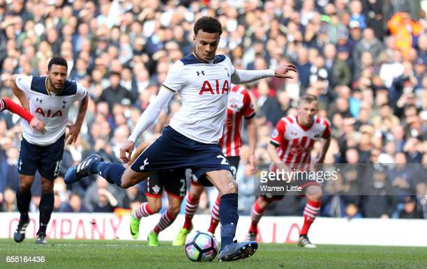 Dele Alli of Tottenham Hotspur scores his sides second goal from the penalty spot during the Premier League match between Tottenham Hotspur and...