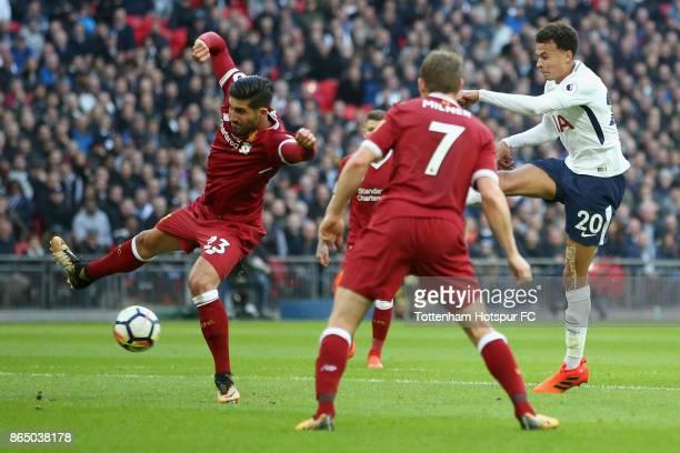 Dele Alli of Tottenham Hotspur scores his sides third goal during the Premier League match between Tottenham Hotspur and Liverpool at Wembley Stadium...