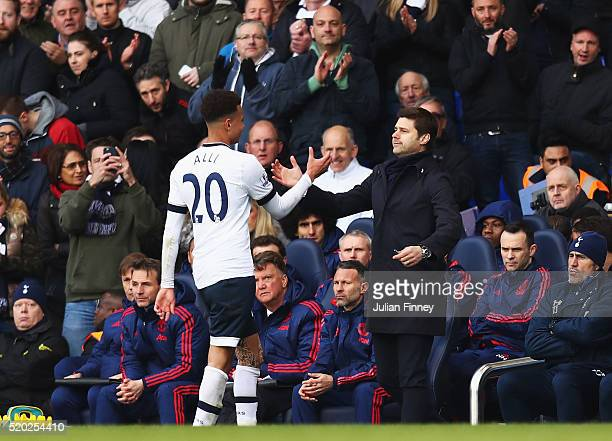 Dele Alli of Tottenham Hotspur shakes hands with Mauricio Pochettino manager of Tottenham Hotspur as he is substituted during the Barclays Premier...