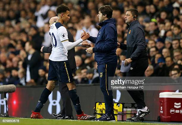 Dele Alli of Tottenham Hotspur shakes hands with Mauricio Pochettino Manager of Tottenham Hotspur after he is subbed during the Premier League match...