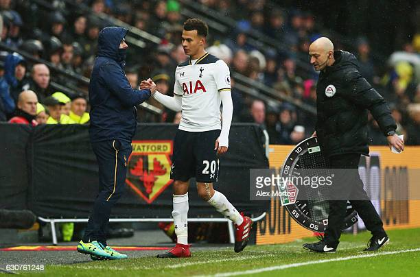 Dele Alli of Tottenham Hotspur shakes hands with Mauricio Pochettino manager of Tottenham Hotspuras he is substituted during the Premier League match...