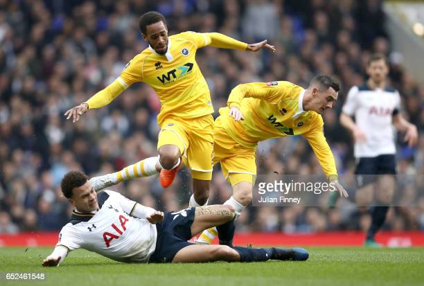 Dele Alli of Tottenham Hotspur Shaun Cummings of Millwall and Shaun Williams of Millwall all battle to win the ball during The Emirates FA Cup...
