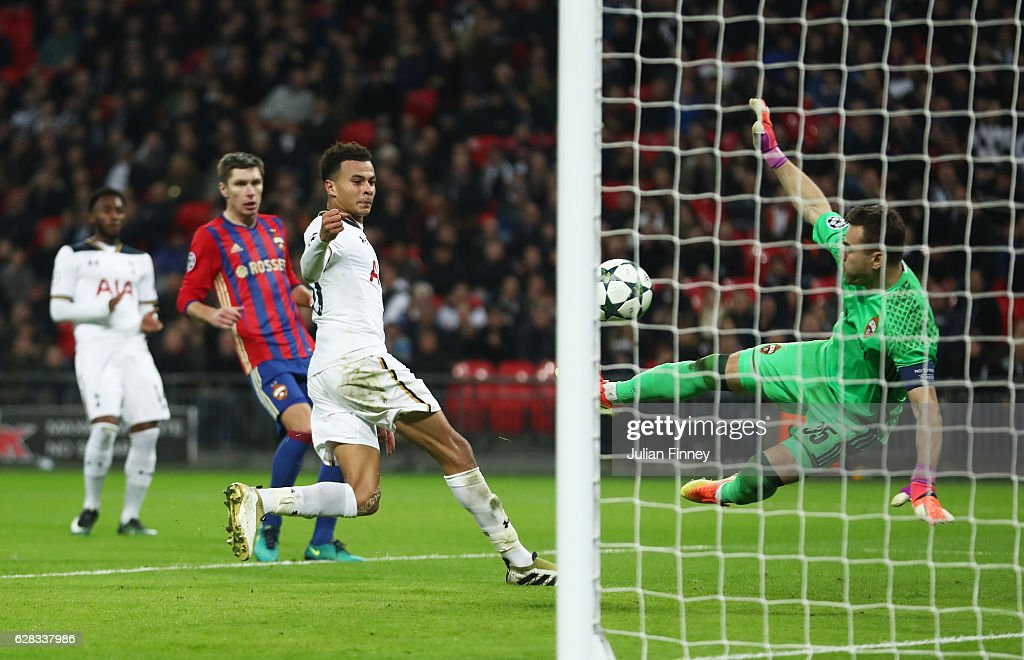 Dele Alli of Tottenham Hotspur shoots and Igor Akinfeev of CSKA Moscow (R) turns it into his own net for Tottenham Hotspurs fourth goal uring the UEFA Champions League Group E match between Tottenham Hotspur FC and PFC CSKA Moskva at Wembley Stadium on December 7, 2016 in London, England.
