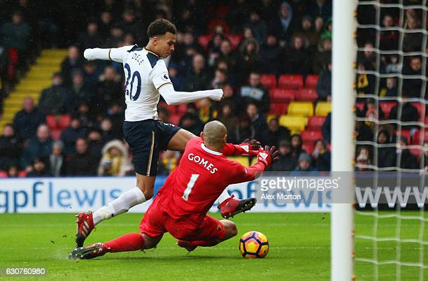 Dele Alli of Tottenham Hotspur shoots past Heurelho Gomes of Watford as he scores their fourth goal during the Premier League match between Watford...