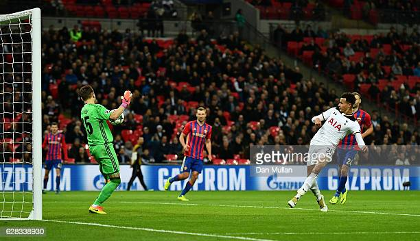 Dele Alli of Tottenham Hotspur shoots which is later turned into the CSKA Moscow goal by Igor Akinfeev of CSKA Moscow for Tottenham Hotspurs third...