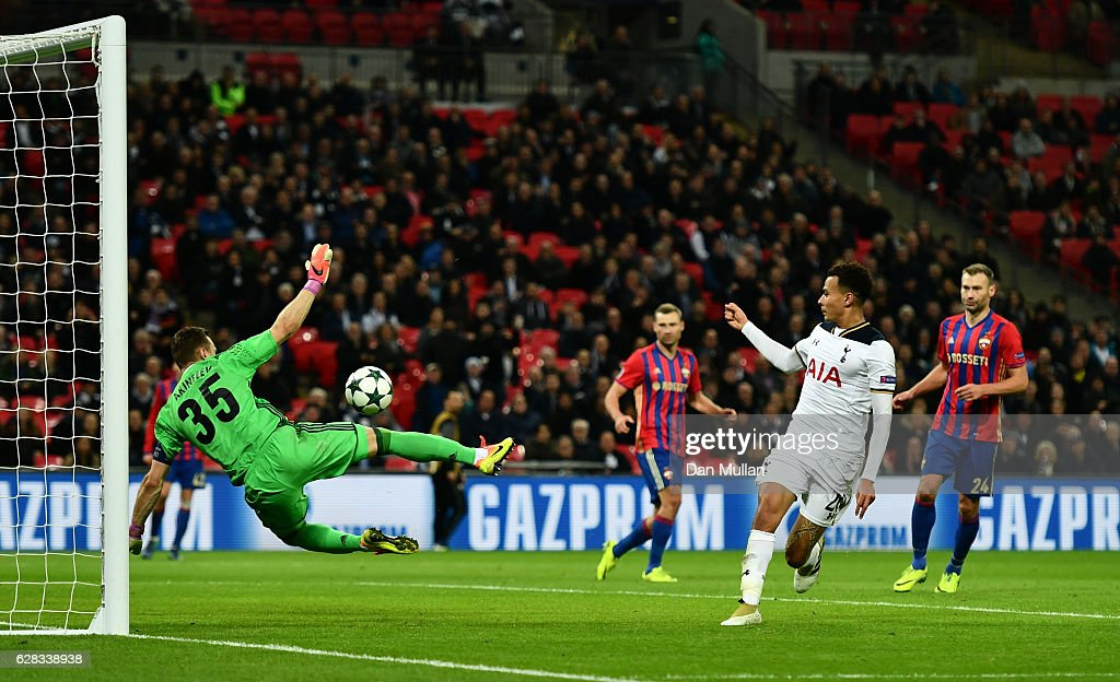 Dele Alli of Tottenham Hotspur (R) shoots which is later turned into the CSKA Moscow goal by Igor Akinfeev of CSKA Moscow (L) for Tottenham Hotspurs third during the UEFA Champions League Group E match between Tottenham Hotspur FC and PFC CSKA Moskva at Wembley Stadium on December 7, 2016 in London, England.