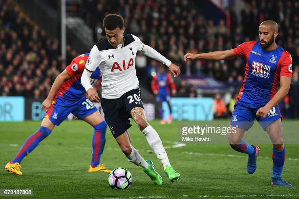 Dele Alli of Tottenham Hotspur takes the ball past Andros Townsend of Crystal Palace during the Premier League match between Crystal Palace and...