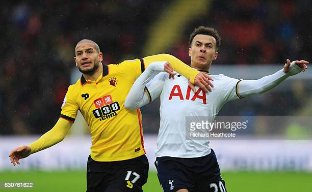 Dele Alli of Tottenham Hotspur tangles with Adlene Guedioura of Watford during the Premier League match between Watford and Tottenham Hotspur at...
