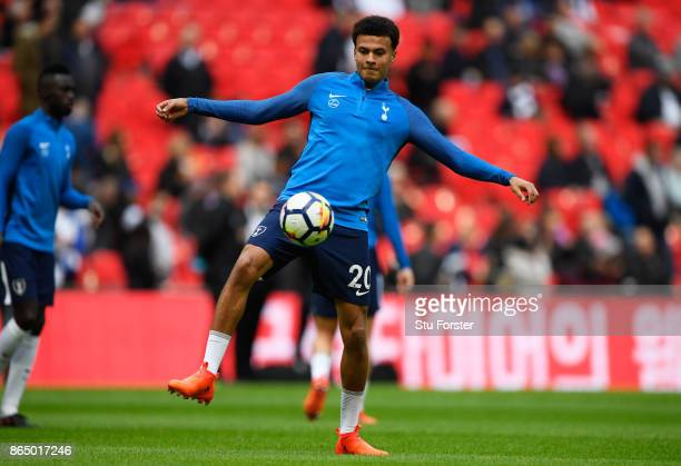 Dele Alli of Tottenham Hotspur warms up prior to the Premier League match between Tottenham Hotspur and Liverpool at Wembley Stadium on October 22...