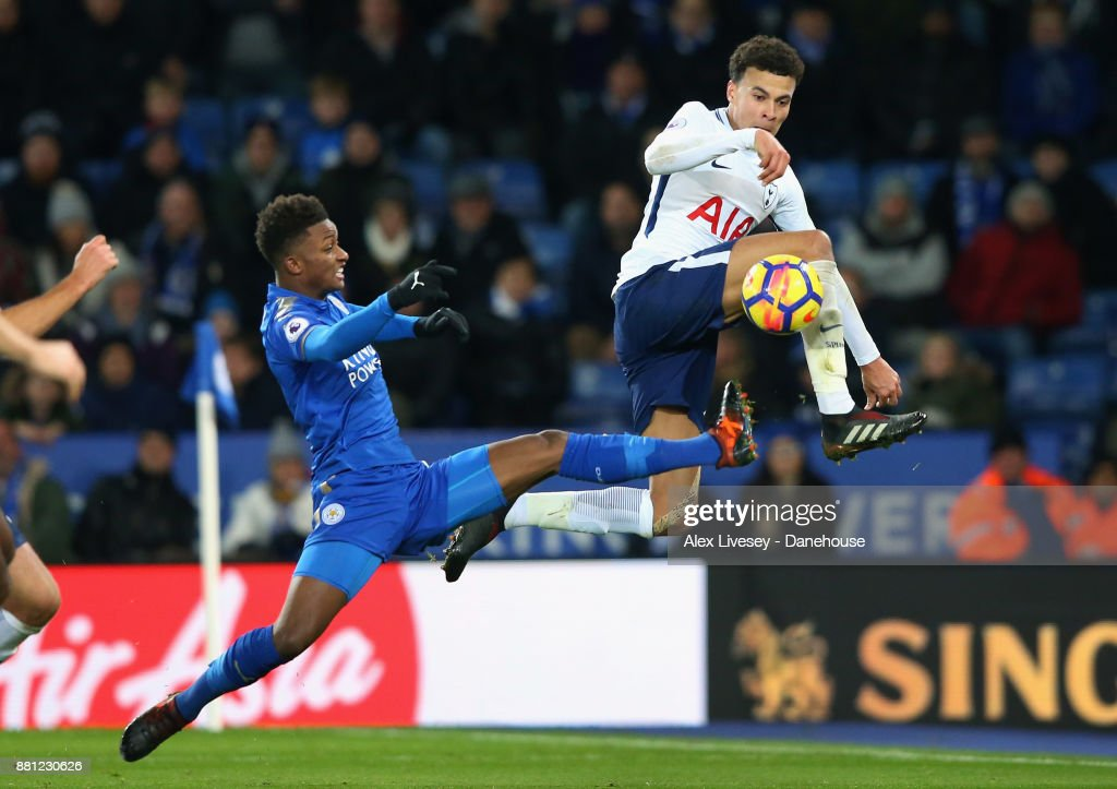 Dele Alli of Tottenham Hotspuris tackled by Demarai Gray of Leicester City during the Premier League match between Leicester City and Tottenham Hotspur at The King Power Stadium on November 28, 2017 in Leicester, England.