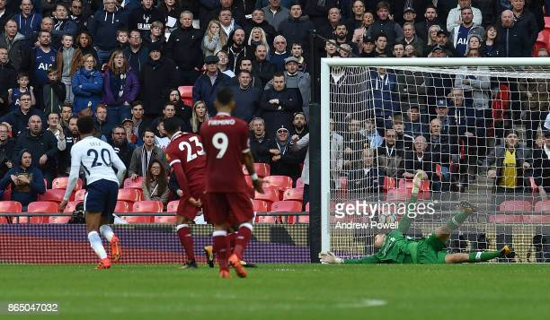 Dele Alli scores the third for Tottenham during the Premier League match between Tottenham Hotspur and Liverpool at Wembley Stadium on October 22...