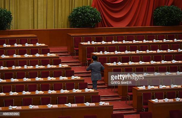 A delegate arrives for the closing ceremony of the Chinese People's Political Consultative Conference an advisory body to the legislature the...