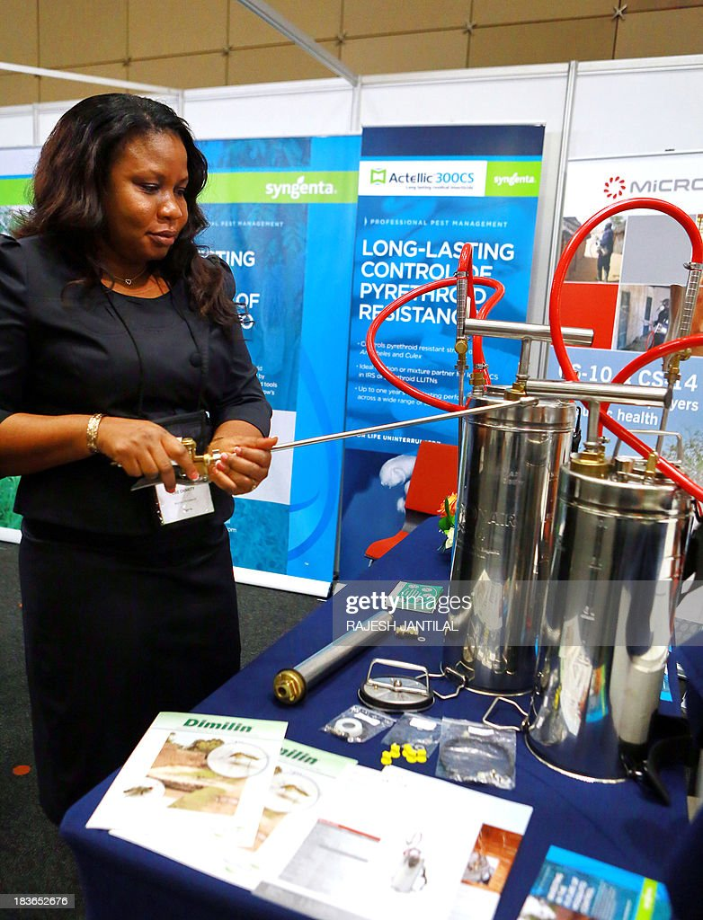 Delegate Charity Obe, from the Arysta Life Science, demonstrates the usage of the Compression Sprayer used to mix insecticides to spread on the walls to combat the spread of malaria in urban and rural households, during the 6th MIM Pan-African Malaria Conference held at the International Convention Centre in Durban on October 8, 2013.The theme of the conference is 'Moving Towards Malaria Elimination: Investing in Research And Control'. The conference ends on October 11, 2013. AFP PHOTO / RAJESH JANTILAL