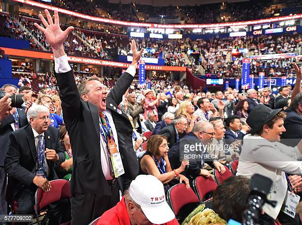 TOPSHOT A delegate cheers during the roll call of states on the second day of the Republican National Convention on July 19 2016 at Quicken Loans...