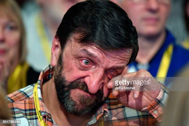 A delegate cries while listening to LGBT speeches at the SNP spring conference prior to the keynote speech by First Minister Nicola Sturgeon on March...