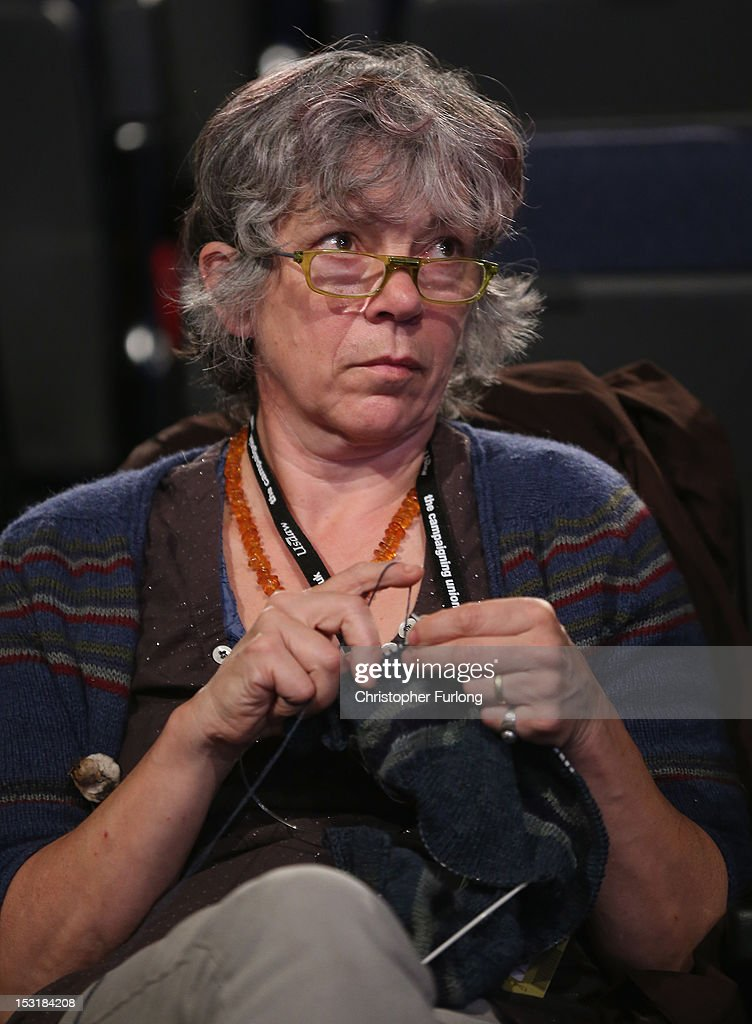 A delegate does her knitting whilst listening to speakers during the Labour Party Conference at Manchester Central on October 1, 2012 in Manchester, England. Labour shadow chancellor Ed Balls unveiled his plans to stimulate the economy, using a GBP 3bn windfall from the sale of 4G mobile phone frequencies to build 100,000 affordable homes and give stamp duty breaks to first time buyers.