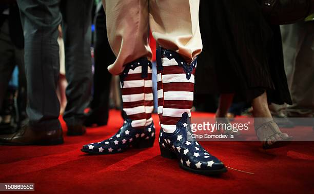 Delegate Don Genhart wears American flag cowboy boots during the Republican National Convention at the Tampa Bay Times Forum on August 28 2012 in...