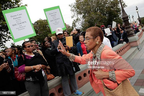 Delegate Eleanor Holmes Norton tries to quiet protesters seeking continued funding for the Washington DC government in front of the US Capitol as...