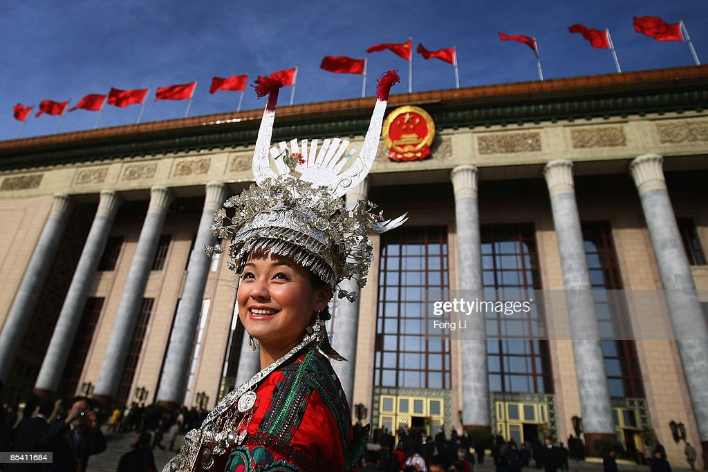 A delegate from Chinese ethnic minority groups arrives at the Great Hall of the People before the closing session of the National People's Congress on March 13, 2009 in Beijing, China.