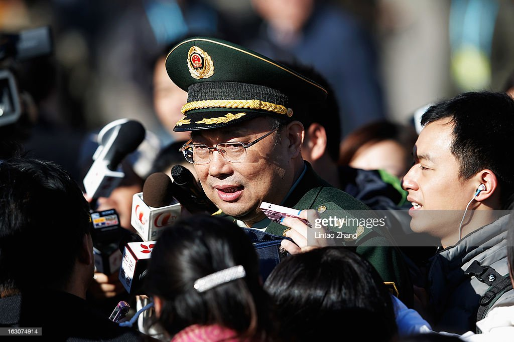 A delegate from Chinese People's Liberation Army answers questions form members of the media outside the Great Hall of the People before a pre-opening session of the National People's Congress (NPC), China's parliament, on March 4, 2013 in Beijing, China. Over 2,000 members of the 12th National Committee of the Chinese People's Political Consultative, a political advisory body, are attending the annual session, during which they will discuss the development of China.