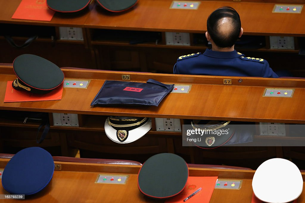A delegate from Chinese People's Liberation Army attends the sixth plenary meeting of the National People's Congress at the Great Hall of the People on March 16, 2013 in Beijing, China. The new lineup of China's State Council, nominated by Premier Li Keqiang, was endorsed by lawmakers at the ongoing national legislative session Saturday afternoon.