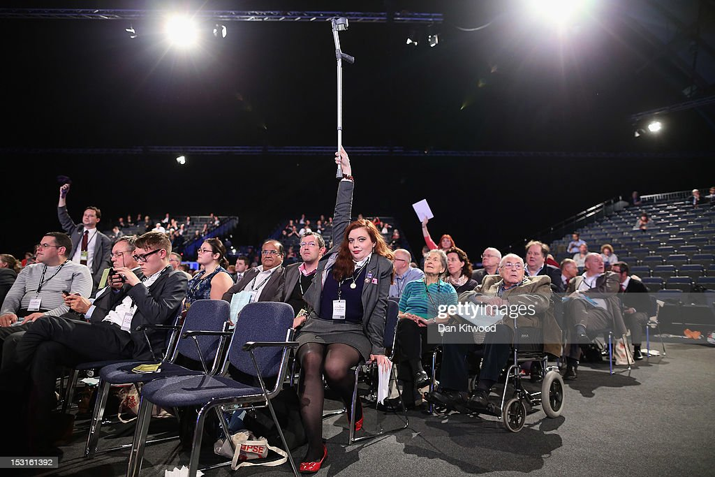 A delegate holds a crutch in the air to attract attention during the Labour Party Conference at Manchester Central on October 1, 2012 in Manchester, England. Labour shadow chancellor Ed Balls unveiled his plans to stimulate the economy, using a GBP 3bn windfall from the sale of 4G mobile phone frequencies to build 100,000 affordable homes and give stamp duty breaks to first time buyers.