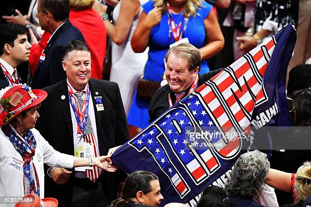 A delegate holds a flag that reads 'Trump Make America Great Again' on the floor prior to the start of the third day of the Republican National...