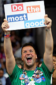 A delegate holds a sign that reads 'Do the most good' during roll call on the second day of the Democratic National Convention at the Wells Fargo...