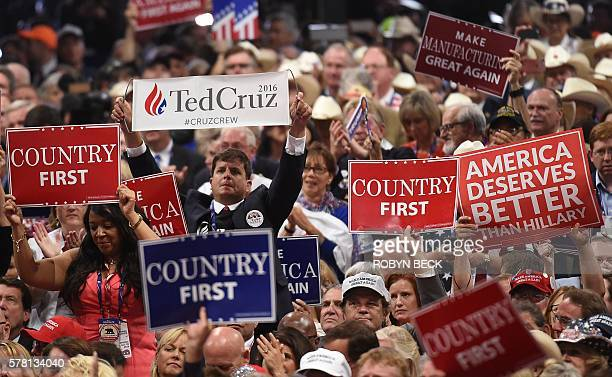 A delegate holds up a sign for Ted Cruz during the Republican National Convention at the Quicken Loans Arena in Cleveland Ohio on July 20 2016 The...