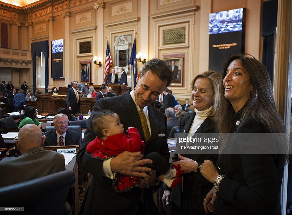 Delegate Joe Morrisey (D-74th) shows his new baby Kennedy Morrisey, 15-weeks-old to Delegate Kay Kory (D-38th) Fairfax County (in center) and Delegate Eileen Filler-Corn (D-41st) Fairfax County (on right) inside the House Chambers on the Opening Day of the 2013 Legislative Session in Richmond on Wednesday, January 9, 2013.
