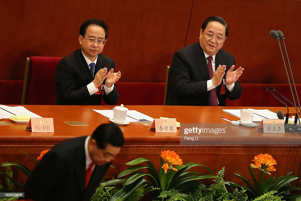 Delegate Ling Jihua (Left) and Yu Zhengsheng (Right) applaud as Chairman of the Chinese People's Political Consultative Conference Jia Qinglin (Below) bowing during the opening session of the Chinese People's Political Consultative Conference in Beijing's Great Hall of the People on March 3, 2013 in Beijing, China. Over 2,000 members of the 12th National Committee of the Chinese People's Political Consultative, a political advisory body, are attending the annual session, during which they will discuss the development of China.