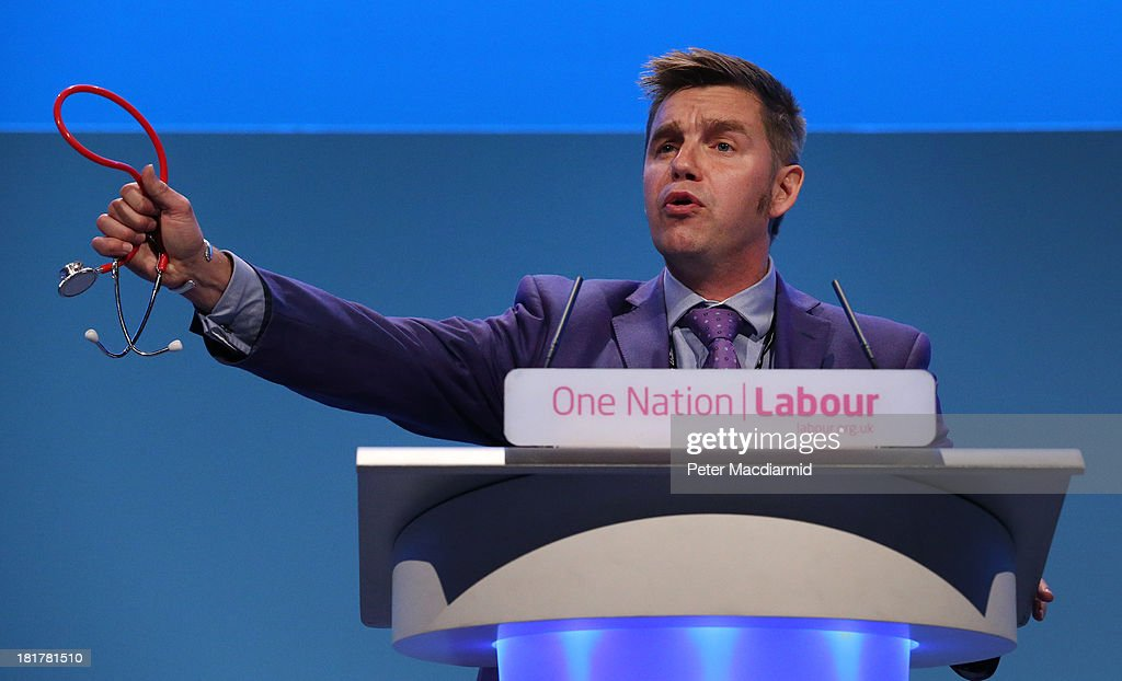 Delegate Nik Johnson holds up a stethoscope as he speaks during a health debate at the Labour Party conference on September 25, 2013 in Brighton, England. Party leader Ed Miliband will take part in a question and answer session later on the last day of conference.