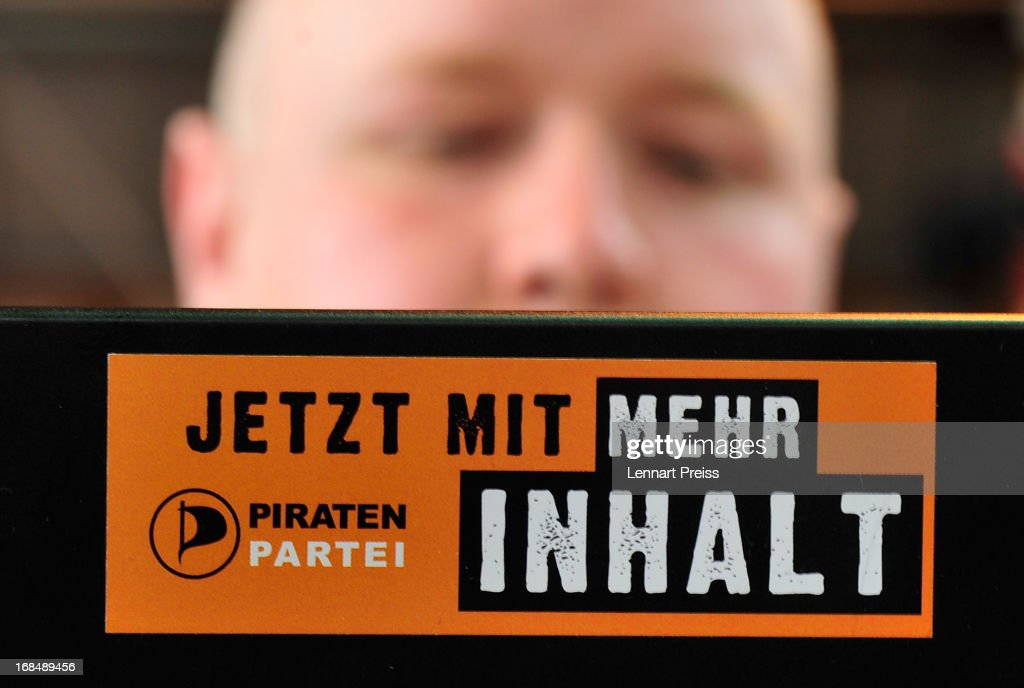 A delegate of the German Pirates Party (Die Piraten) sits behind his laptop prior to the party's federal congress on May 10, 2013 in Neumarkt, Germany. The Pirates rode a wave of popularity driven by voter discontent with Germany's established political parties that won the Pirates seats in several state parliaments. More recently, however, the Pirates have faltered, as political infighting, leadership changes and an unclear political message have contributed to a loss of support. Germany faces federal elections in September and at current polls the Pirates would fail to pass the 5% hurdle necessary to gain seats in the Bundestag.