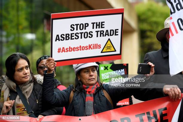 A delegate of union snaps a selfie during a demonstration for the inclusion of chrysotile a mineral also known as white asbestos which health experts...