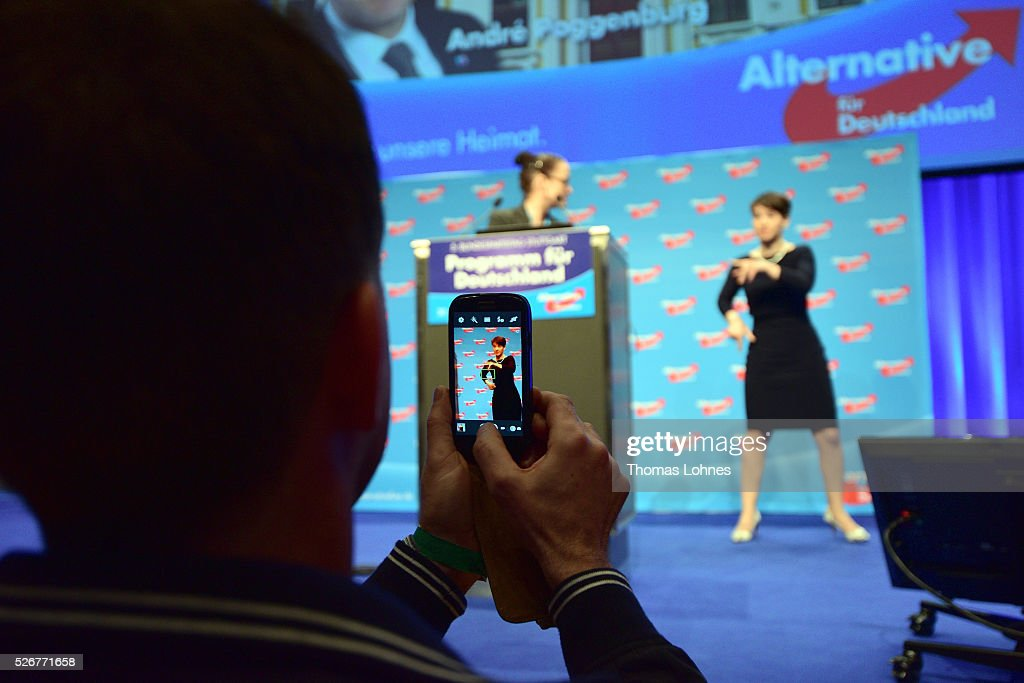 A delegate pictures Frauke Petry, head of the Alternative fuer Deutschland (AfD) political party, at the party's federal congress on May 01, 2016 in Stuttgart, Germany. A server of the party had been hacked by a left political group and the addresses of AfD members has been published. The AfD, a relative newcomer to the German political landscape, has emerged from Euro-sceptic conservatism towards a more right-wing leaning appeal based in large part on opposition to Germany's generous refugees and migrants policy. Since winning seats in March elections in three German state parliaments the party has sharpened its tone, calling for a ban on minarets and claiming that Islam does not belong in Germany.
