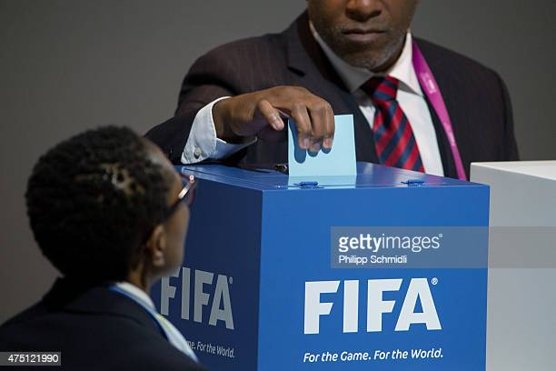 FIFA delegate places his vote in the ballot box during the Presidental Election at the 65th FIFA Congress at Hallenstadion on May 29 2015 in Zurich...
