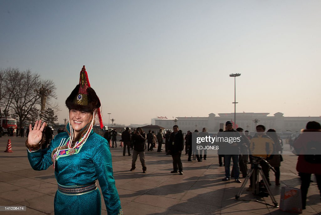 A delegate representing an ethnic minority walks to the Great Hall of the People during the last day of the Chinese People's Political Consultative Conference (CPPCC) during the National People's Congress (NPC) in Beijing on March 13, 2012. The 2012 NPC session is the last before a handover of power that begins later this year, and leaders are anxious to ensure the world's second-largest economy grows at a steady pace while keeping a lid on social unrest. AFP PHOTO / Ed Jones