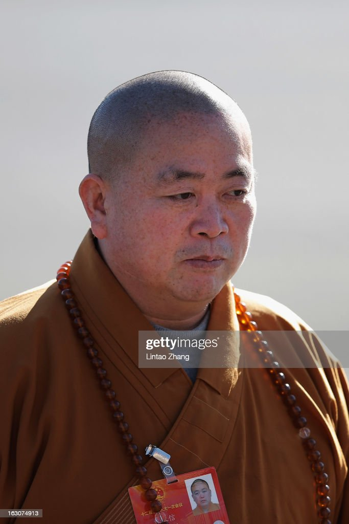 Delegate <a gi-track='captionPersonalityLinkClicked' href=/galleries/search?phrase=Shi+Yongxin&family=editorial&specificpeople=224082 ng-click='$event.stopPropagation()'>Shi Yongxin</a>, Abbot of Shaolin Temple, arrives at The Great Hall Of The People attend a pre-opening session of the National People's Congress (NPC), China's parliament on March 4, 2013 in Beijing, China. Over 2,000 members of the 12th National Committee of the Chinese People's Political Consultative, a political advisory body, are attending the annual session, during which they will discuss the development of China.