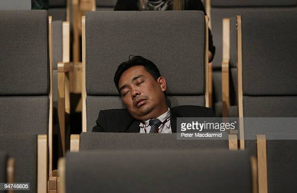 A delegate sleeps in the main press conference room on the final day of the UN Climate Change Conference on December 18 2009 in Copenhagen Denmark...