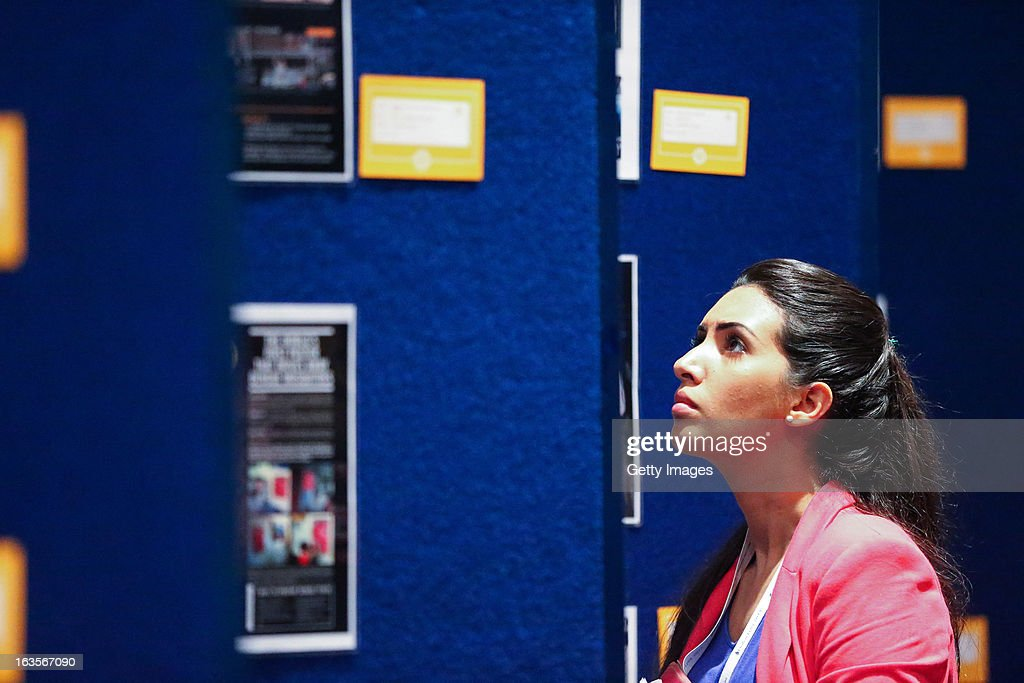 A delegate takes time to view a display of successful advertising campaigns from around the world, at the Madinat Jumeirah on March 12, 2013 in Dubai, United Arab Emirates.