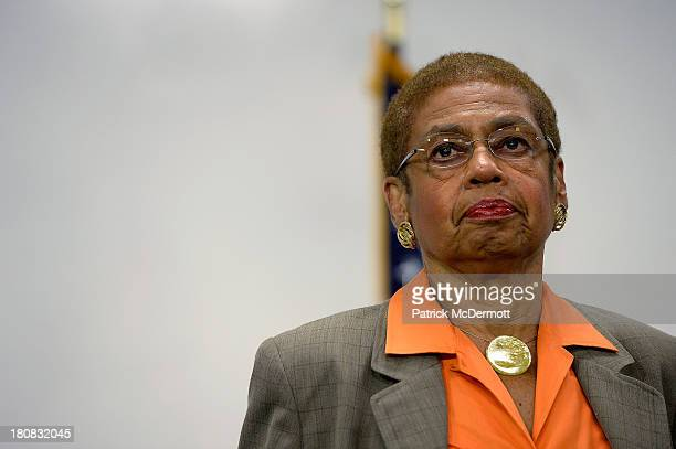 Delegate to the US House of Representatives Eleanor Holmes Norton listens during an evening news briefing at a DC government building not far away...