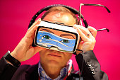 A delegate tries on a Gear VR headset manufactured by Samsung Electronics Co at the Mobile World Congress in Barcelona Spain on Monday Feb 22 2016...