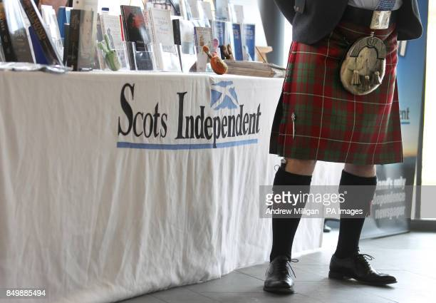 A delegate views a book stall at the SNP Spring conference being held at the Eden Court in Inverness