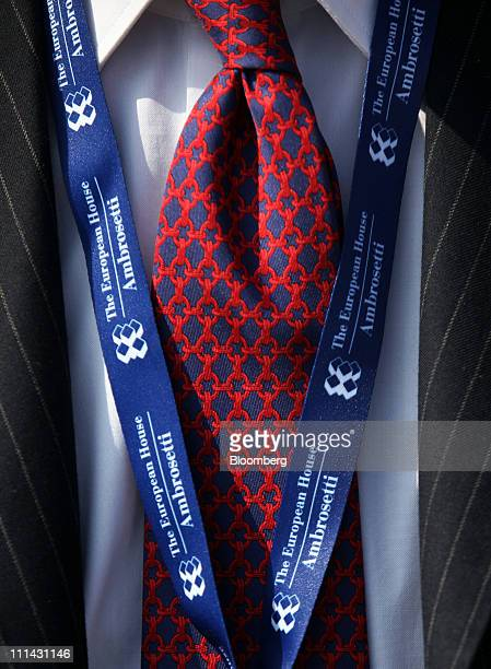 A delegate wears a branded security lanyard during the Ambrosetti Workshop in Cernobbio near Como Italy on Saturday April 2 2011 The Cernobbio...